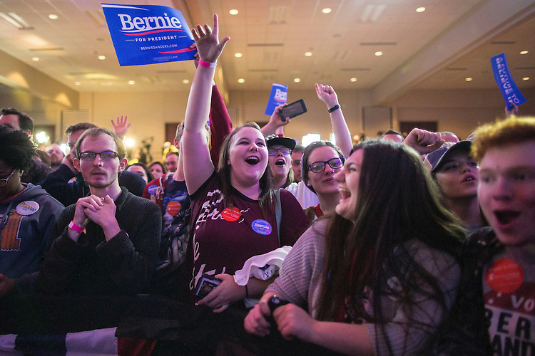 UNITED STATES - FEB 1. - A supporter cheers as the results come in from the Democratic caucus at the caucus night rally for Democratic presidential candidate Sen. Bernie Sanders, I-Vt., at the Holiday Inn Des Moines Airport and Conference Center, on Monday, Feb. 1, 2016 in Des Moines, Iowa. (Photo By Al Drago/CQ Roll Call)