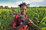 Charity Soko works in her farm field in Thundira, Malawi.