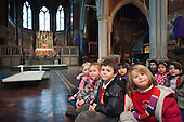 Pupils from St Mary Magdalene Church of England Primary School attend an Easter service at its parent church in North Paddington, London.