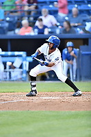 Asheville Tourists shortstop Carlos Herrera (2) lays down a bunt during a game against the West Virginia Power at McCormick Field on May 10, 2017 in Asheville, North Carolina. The Tourists defeated the Power 4-3. (Tony Farlow/Four Seam Images)