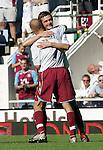 West Ham's George McCartney celebrates his goal with Freddi Ljungberg. .Pic SPORTIMAGE/David Klein