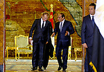 A handout picture made available by the Egyptian Presidency on September 19, 2015, shows Egyptian President Abdel Fattah al-Sisi walking alongside EU President Donald Tusk following a meeting in the capital Cairo. Photo by Egyptian President Office