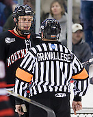 Anthony Bitetto (Northeastern - 7), John Gravallese - The visiting Northeastern University Huskies defeated the University of Massachusetts-Lowell River Hawks 3-2 with 14 seconds remaining in overtime on Friday, February 11, 2011, at Tsongas Arena in Lowelll, Massachusetts.