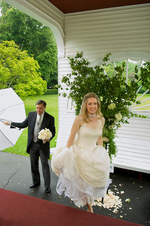 Bride entering the chapel with her dad in the background, East Hampton, NY