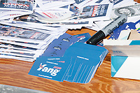 """Campaign materials are seen on a table before entrepreneur and Democratic presidential candidate Andrew Yang speaks at a campaign rally in Cambridge Common near Harvard Square in Cambridge, Massachusetts, on Mon., September 16, 2019. Yang's unlikely presidential bid is centered on his idea for a """"Freedom dividend,"""" which would give USD$1000 per month to every adult in the United States. After appearing in three Democratic party debates, Yang has risen in polls from longshot candidate to within the top 10."""