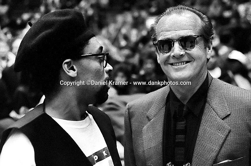 Spike Lee and three-time Academy Award winning actor Jack Nicholson chat courtside during a Los Angeles Lakers game at the Forum in 1992.