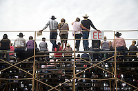 People sit on the grandstand to watch the Pendleton Roundup in Pendleton, Oregon, USA.