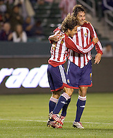 Chivas USA FWD Ante Razov (9) celebrates his 100th goal of his Major League Soccer career with team mate Chivas MID Francisco Mendoza (6). Chivas USA beat Real Salt Lake 4-0 at the Home Depot Center in Carson, California, Saturday, April 21, 2007.