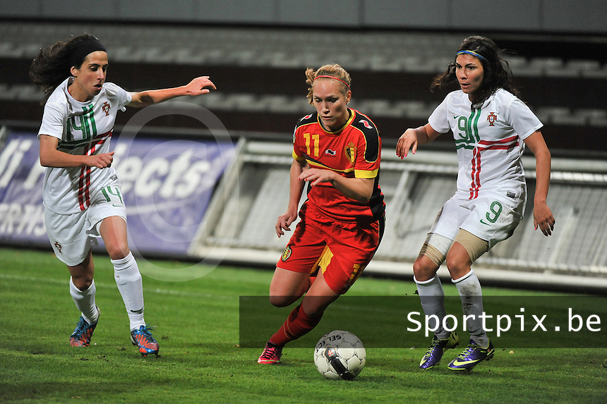 20131031 - ANTWERPEN , BELGIUM : Belgian Janice Cayman (11) pictured in between Portugese Ana Borges (9) and Portugese Dolores Silva during the female soccer match between Belgium and Portugal , on the fourth matchday in group 5 of the UEFA qualifying round to the FIFA Women World Cup in Canada 2015 at Het Kiel stadium , Antwerp . Thursday 31st October 2013. PHOTO DAVID CATRY