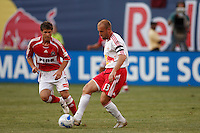 NY Red Bulls midfielder (13) Clint Mathis is marked by Chicago Fire midfielder (7) Logan Pause. The Red Bulls defeated the Chicago Fire 3-0 at Giants Stadium, East Rutherford, NJ, on May 24, 2007.