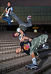 B-Boys Taisuke, Ronnie and Lilou in action on Hong Kong's Victoria Harbour waterfront.