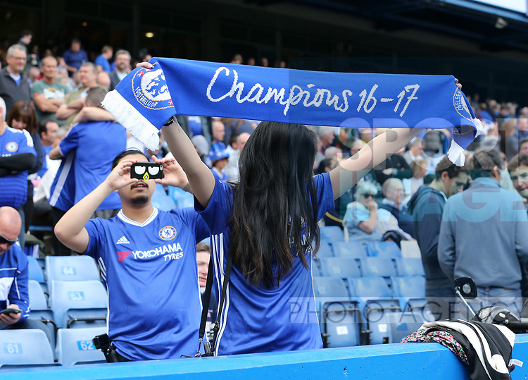 Chelsea's tourist fans take photos during the Premier League match at Stamford Bridge Stadium, London. Picture date: May 18th, 2017. Pic credit should read: David Klein/Sportimage