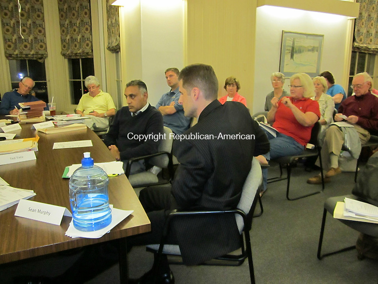 WOODBURY, CT - 13 June 2012 - 061312RH01 - David Palmer, front center, listens to public opposition to his zoning application for a mental health residential living center at the current location of Premier Care of Woodbury on Middle Road Turnpike in Woodbury. Rick Harrison Republican-American
