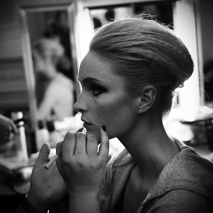 A model sits in makeup backstage during the fall 2009 Arutyunov Sa catwalk show during London Fashion Week, Friday, Feb. 20, 2009 in London. (Tina Gao/pressphotointl.com)
