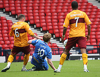 Liam Craig gets to the ball before Tom Hateley