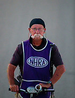Jun 7, 2019; Topeka, KS, USA; NHRA photographer Roger Richards during qualifying for the Heartland Nationals at Heartland Motorsports Park. Mandatory Credit: Mark J. Rebilas-USA TODAY Sports