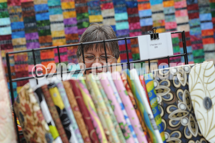 NEW HOPE, PA - SEPTEMBER 06: Sue Springer of Perkasie, Pennsylvania views some hand crafted iPad covers during Bucks County Guild of Craftsmen's third annual Fine Crafts show at the New Hope Winery September 6, 2014 in New Hope, Pennsylvania. (Photo by William Thomas Cain/Cain Images)