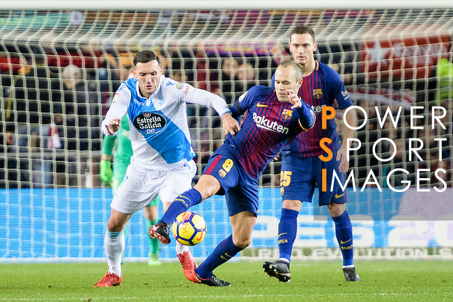 Andres Iniesta of FC Barcelona (C) in action against Jose Luis Mato Sanmartin, Joselu, of RC Deportivo La Coruna (L) during the La Liga 2017-18 match between FC Barcelona and Deportivo La Coruna at Camp Nou Stadium on 17 December 2017 in Barcelona, Spain. Photo by Vicens Gimenez / Power Sport Images