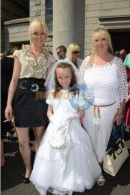 Charmaine Kelly pictured with her Mum Victoria and Nana Rosaleen after making her First Communion at the Lourdes Church on Saturday. www.newsfile.ie