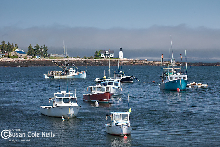Lobster boats and Prospect Harbor Light in Prospect Harbor, Gouldsboro, ME, USA