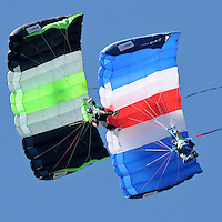 NWA Democrat-Gazette/BEN GOFF @NWABENGOFF<br /> Brandon Cawood (left) and father Terry Cawood with Skydive Skyranch in Siloam Springs take part in a demonstration dive on Saturday Sept. 12, 2015 during the Sheep Dog Impact Assistance annual Patriot Day event at Bentonville Municipal Airport. The event honored the victims of the Sept. 11, 2001 terrorist attacks and offered visitors a chance to get an up close look at military and emergency response vehicles.