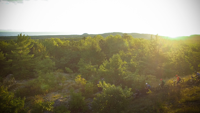 Mountain bikers in the Marji Gesick 100 event descend from Top of the World Overlook during the event in Marquette County, Michigan.