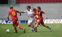Ellen Rose Curson of Wales and Hannah Keryakoplis of Wales battle with Anna Fisker of Denmark during the UEFA Womens U19 Championships at Parc y Scarlets, Monday 19th August 2013. All images are the copyright of Jeff Thomas Photography-www.jaypics.photoshelter.com-07837 386244-Any use of images must be authorised by the copyright owner.