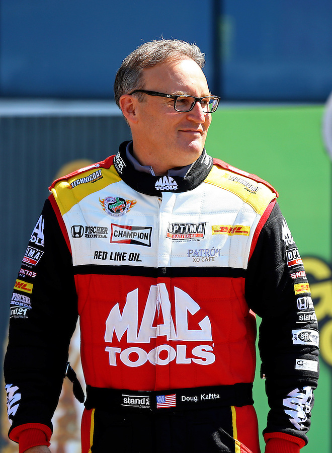 June 1, 2014; Englishtown, NJ, USA; NHRA top fuel driver Doug Kalitta during qualifying for the Summernationals at Raceway Park. Mandatory Credit: Mark J. Rebilas-