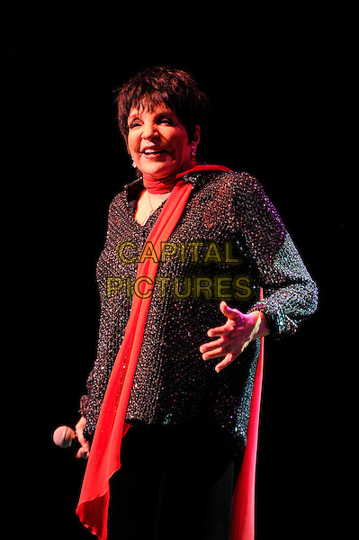 Liza Minnelli.performing in concert, Royal Festival Hall, London, England, UK, .1st March 2013..live music on stage in concert half length red scarf black jacket holding side microphone .CAP/MAR.© Martin Harris/Capital Pictures.