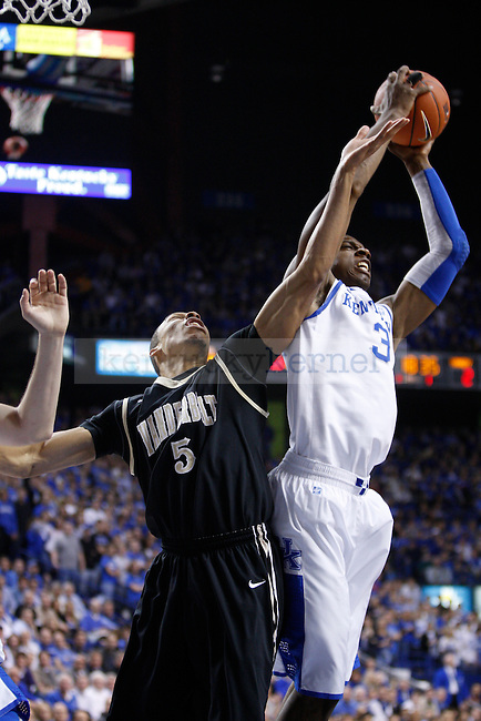 UK's Terrence Jones grabs and offensive rebound against Vanderbilt's  Lance Goulbourne at Rupp Arena on Tuesday, March 1, 2011. Photo by Scott Hannigan | Staff