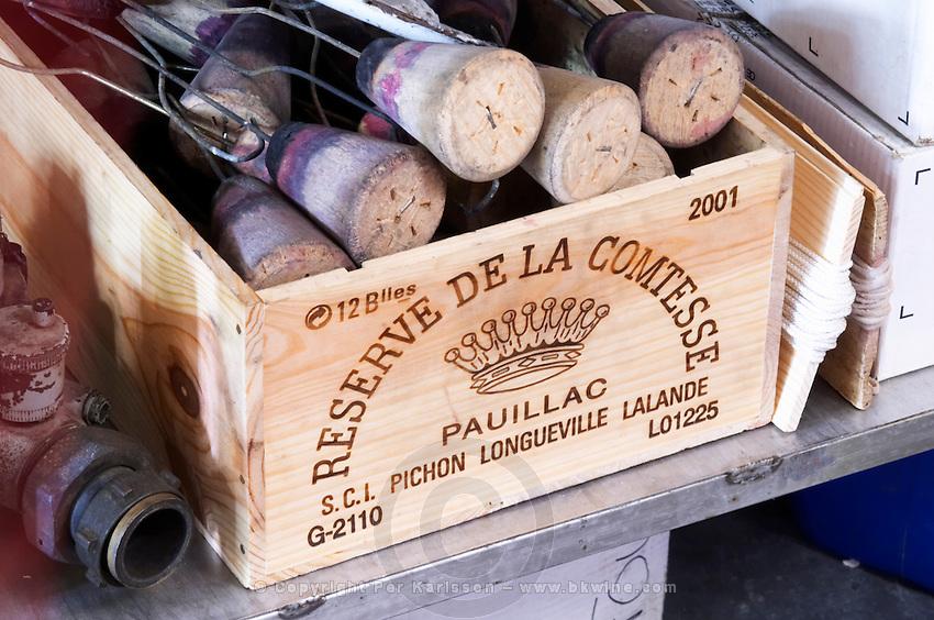 Bung hole stoppers with hook for burning sulphur pellets. Oak barrel aging and fermentation cellar. Chateau Pichon Longueville Comtesse de Lalande, pauillac, Medoc, Bordeaux, France