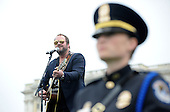 Nashville recording artist Lee Brice sings during the 32nd Annual National Peace Officers' Memorial Service at the West Front Lawn of the U.S. Capitol May 15, 2013 in Washington, DC. Obama attended the annual event to honor law enforcement who were killed in the line of duty in the previous year..Credit: Olivier Douliery / Pool via CNP