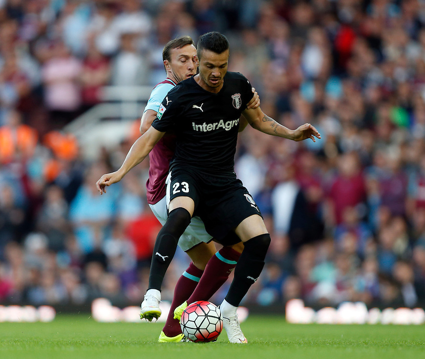FC Astra Giurgiu Fernando Boldrin despite the attentions of  West Ham United's Mark Noble<br /> <br /> Photographer Kieran Galvin/CameraSport<br /> <br /> Football - UEFA Europa League Qualifying Third Round First Leg - West Ham United v Astra Giurgiu - Thursday 30 July 2015 - Boleyn Ground - London<br /> <br /> &copy; CameraSport - 43 Linden Ave. Countesthorpe. Leicester. England. LE8 5PG - Tel: +44 (0) 116 277 4147 - admin@camerasport.com - www.camerasport.com