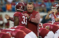 Hawgs Illustrated/BEN GOFF <br /> Bret Bielema, Arkansas head coach, greets players before the game against Florida A&M, Thursday, Aug. 31, 2017, during the game at War Memorial Stadium in Little Rock.