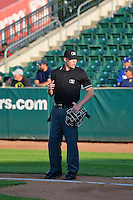 Home plate umpire Andy Stukel during the game against the Great Falls Voyagers and the Ogden Raptors on July 17, 2014 at Lindquist Field in Ogden, Utah. (Stephen Smith/Four Seam Images)
