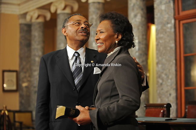 Senator Roland Burris stands with his wife Berlean Burris before a swearing in ceremony in the old Senate chamber of the U.S. Senate in Washington, DC on January 15, 2008.