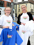 Megan Reilly and Tanya Adare selling the 20th anniverary Samba festival t-shirts. Photo:Colin Bell/pressphotos.ie