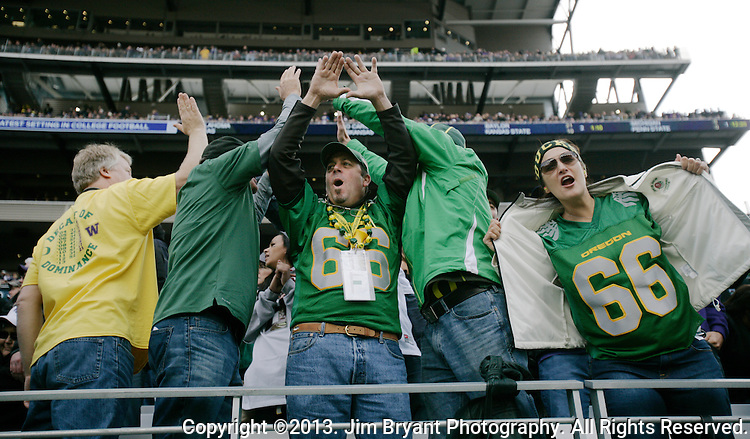 Oregon Ducks fans celebrates a touchdown against Washington in a college football game against Washington at Husky Stadium in Seattle, Washington on October 12, 2013. The Oregon Ducks beat the Washington Huskies 45-24.  © 2013. Jim Bryant Photo. All Rights Reserved.