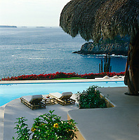 The terraces descend from the house to the swimming pool area and then on over the cliff to the Pacific Ocean