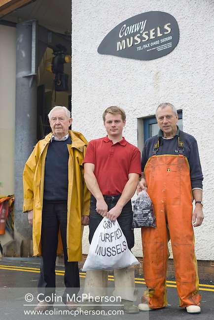 Tom Jones, the last mussel fisherman who uses traditional raking methods to collect the mussels, at Conwy, north Wales. Mr Jones works with his father, Trevor and grandfather Ken (pictured) in the family business located at Conwy quay.