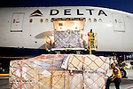 Ground crew members unload cargo after the arrival of a Delta 777 flight from Johannesburg, South Africa at Gate F8 outside of the Maynard H. Jackson Jr. International Terminal at Hartsfield–Jackson Atlanta International Airport, in Atlanta, Georgia on August 28, 2013.
