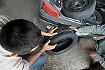 George Saadeh, 2009 Palestine speed test champion, prepares his car at a garage in Beit Jala, near Bethlehem on 18/05/2009. George inspects new semi slick tyres ahead of the second meet of the season in Nablus on Friday 21st May 2010.