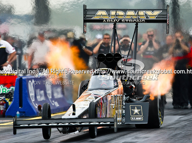 Champion Tony Schumacher #1, driver for the Army's Top Fuel Dragster makes a  run at the O'Reilly Fall Nationals held at the Texas Motorplex in  Ennis, Texas.