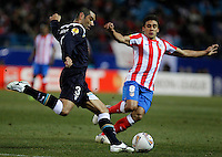 Atletico de Madrid's Eduardo Salvio (r) and Lazio's Andre Dias during Europa League match.February 23,2012. (ALTERPHOTOS/Acero)