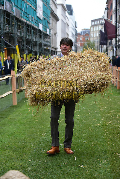 Alex James launches Wool Week as Savile Row is transformed into green pasture and populated with real sheep.  The iconic street was transformed into a luscious green pasture, completely covered in turf and closed to traffic while real life Merino and Exmoor Longhorn sheep graze along the Row.<br /> CAP/JOR<br /> &copy;JOR/Capital Pictures