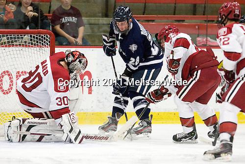 Raphael Girard (Harvard - 30), Grayson Downing (UNH - 28), Colin Blackwell (Harvard - 63) - The Harvard University Crimson defeated the University of New Hampshire Wildcats 7-6 on Tuesday, November 22, 2011, at Bright Hockey Center in Cambridge, Massachusetts.