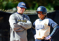 Florida International University Head Coach Jake Schumann and outfielder/left handed pitcher Ashley McClain (2) during the game against the University of Illinois.  FIU won the game 8-0 on February 12, 2012 at Miami, Florida. .