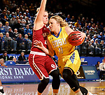 BROOKINGS, SD - DECEMBER 6: Madison Guebert #11 from South Dakota State drives into the defense of Gabbi Ortiz #21 from Oklahoma during their game Wednesday night at Frost Arena in Brookings. (Photo by Dave Eggen/Inertia)