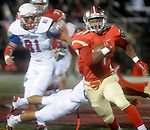 (Everett Ma 091914) Everett 1, Nick Orekoya, gets by a diving Tewksbury 7, Ryan Bednarek, as Orekoya makes it in to the end zone, during the first quarter of the game, Friday, Sept. 19, 2014, at Everett Stadium. (Jim Michaud Photo) For Saturday