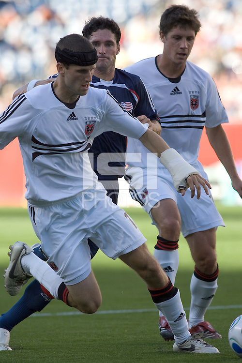 D. C. United (17) Joshua Gros and (15) Rod Dyachenko frustrate New England Revolution (6) Jay Heaps on a run toward net. DC United defeated the New England Revolution, 3-0, at Gillette Stadium, Foxborough, MA on August 5, 2007.